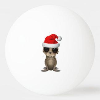 Bola Para Ping-pong Leão de mar do bebê que veste um chapéu do papai