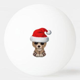 Bola Para Ping Pong Urso do bebê que veste um chapéu do papai noel