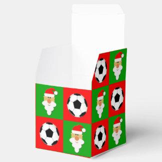 Bolas de futebol & caixa de Natal vermelhas &