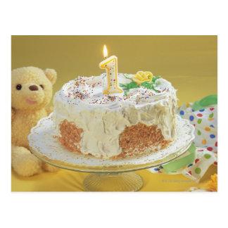 Bolo de aniversário com o um urso da vela e de urs cartoes postais