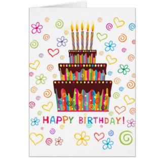 Bolo e velas do cartão do feliz aniversario