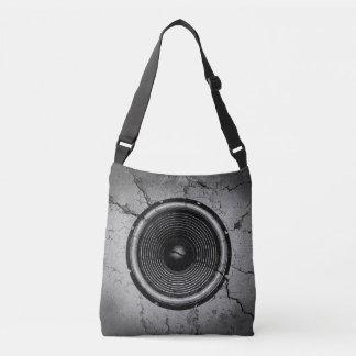 Bolsa Ajustável Auto-falante da música em uma parede rachada