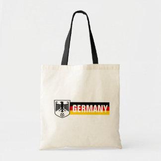 Bolsa Tote A bandeira de Alemanha colore o futebol da brasão