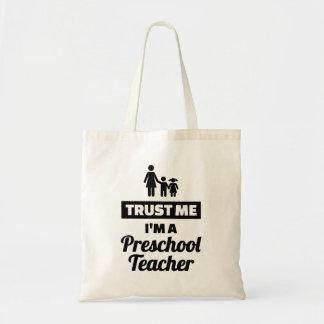 Bolsa Tote Confie que eu mim é um professor pré-escolar