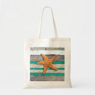 Bolsa Tote Estrela do mar e praia resistida das pranchas