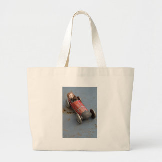 Bolsa Tote Grande Macaco em um carro do brinquedo
