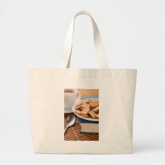 Bolsa Tote Grande Placa branca com os biscoitos no livro velho