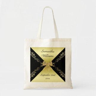 Bolsa Tote Ouro à moda & arco decorativo preto algum evento