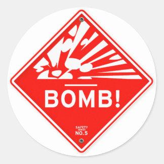 Bomba da segurança que adverte o cuidado vermelho adesivo