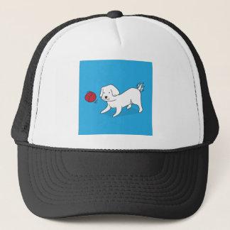 Boné Cão que joga com uma bola