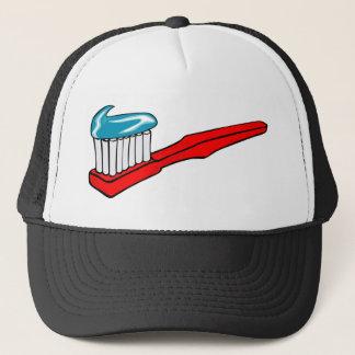 Boné Escova de dentes e dentífrico