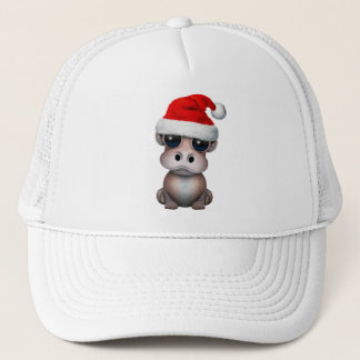 Boné Hipopótamo do bebê que veste um chapéu do papai