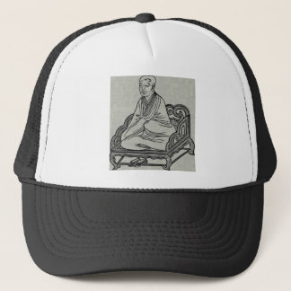 Boné Homem que senta-se na pose da meditação
