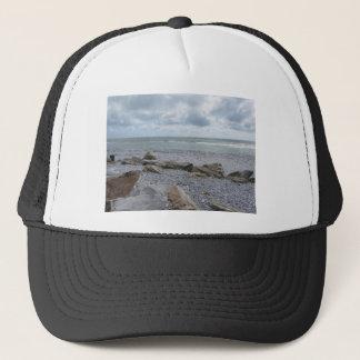 Boné Litoral da praia com os veleiros no horizonte