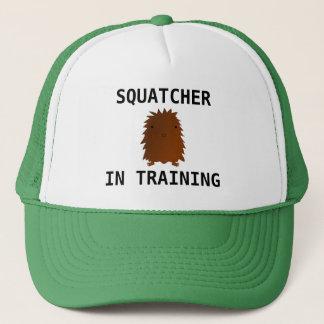 Boné Squatcher no bebê bigfoot do treinamento