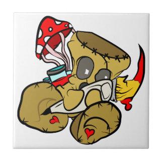 Boneca do Voodoo que guardara o pincel no vermelho