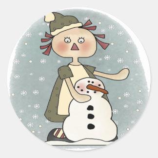 Boneca e boneco de neve de pano adesivo