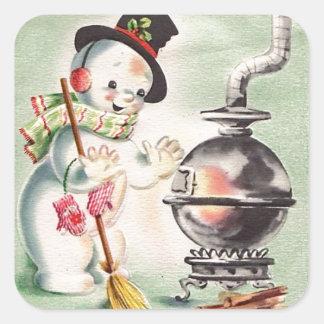 Boneco de neve do vintage pelo fogão de madeira adesivo quadrado
