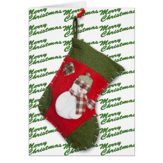 Boneco de neve no Natal que armazena sobre o Cartão Comemorativo