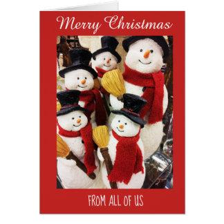 Bonecos de neve dtodos nós cartão do Feliz Natal