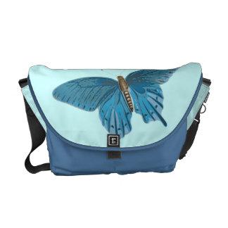 Borboleta azul em vôo bolsas mensageiro