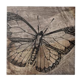 Borboleta do vintage azulejo de cerâmica