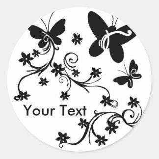 Borboletas com etiquetas pretas do branco das adesivo