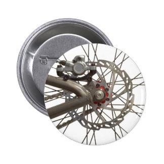 Botão com o cubo de roda da bicicleta botons