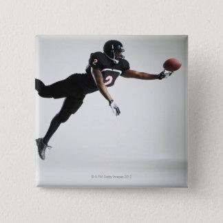 Bóton Quadrado 5.08cm Jogador de futebol que pula no meio do ar para