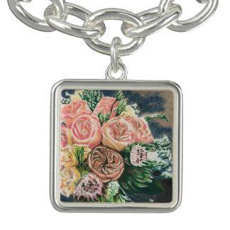 Bracelete tirado mão do encanto do buquê floral