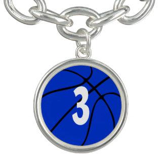 Braceletes Número ou inicial azul do jérsei do jogador de