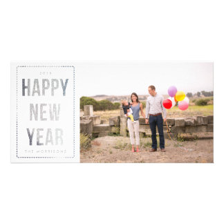 Brilho de prata do falso do feliz ano novo no cartão com foto