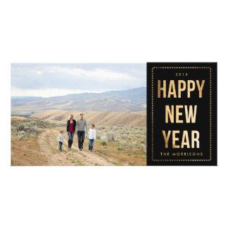 Brilho do falso do feliz ano novo do ouro no preto cartão com foto
