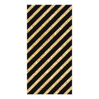 Brilho do ouro e teste padrão diagonal preto das cartão com foto