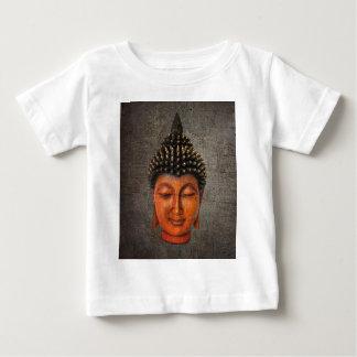 Cabeça de Buddha na luz afligida do duro do fundo Camiseta Para Bebê