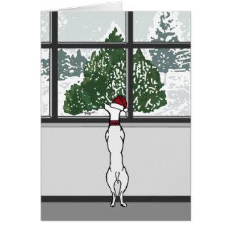Cachorrinho no cartão da janela do Natal