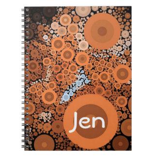 Caderno alaranjado floral dos círculos