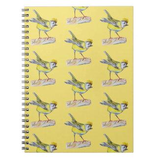 Caderno amarelo da foto do desenho do pássaro