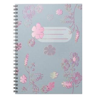 Caderno azul e cor-de-rosa