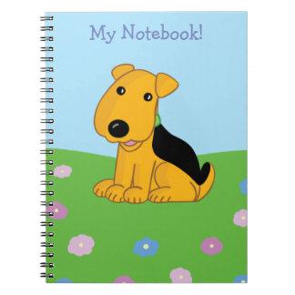 Caderno bonito do campo do cão de filhote de