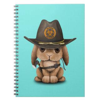 Caderno Caçador do zombi do coelho do bebê