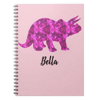 Caderno cor-de-rosa brilhante do dinossauro a