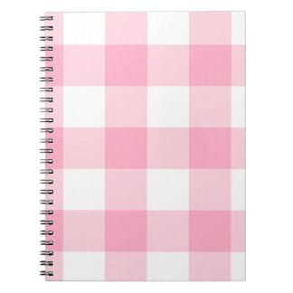 Caderno cor-de-rosa e branco da verificação do