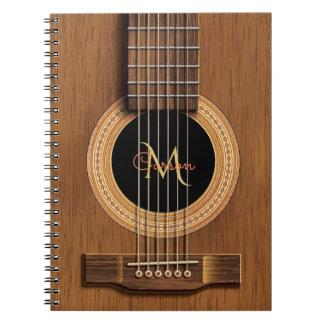 Caderno de madeira morno da guitarra acústica
