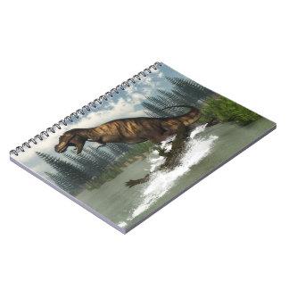 Caderno Dinossauro do rex do tiranossauro atacado pelo