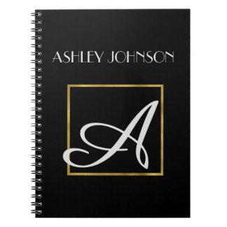 Caderno do monograma da folha de ouro para a cadernos