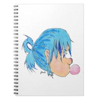 Caderno Espiral Adolescente fundindo uma bolha com goma