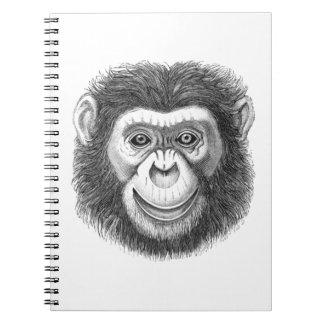 Caderno espiral da ilustração da cara do chimpanzé
