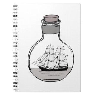 Caderno Espiral O navio no bulbo de vidro