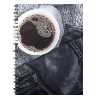 Caderno Espiral Vista superior de um copo branco com café